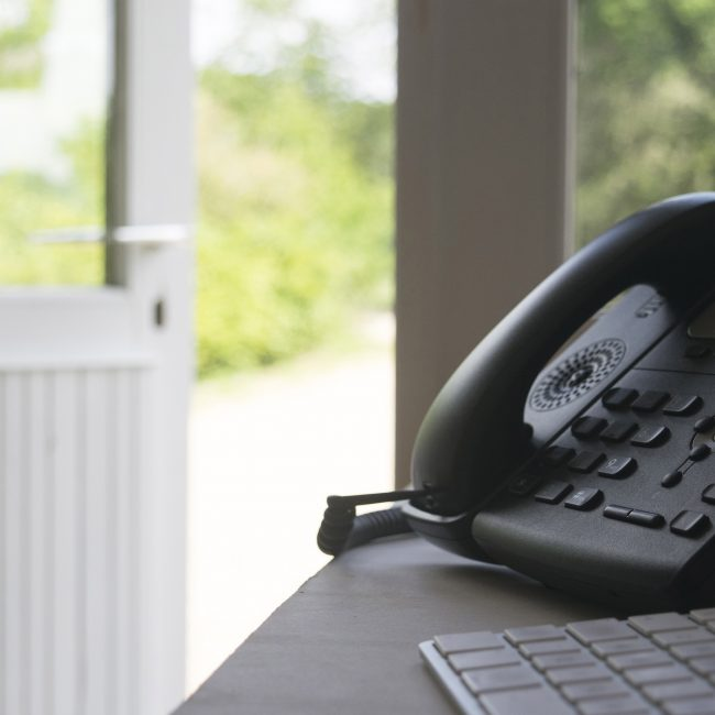 Image of the Greenfields office and phone